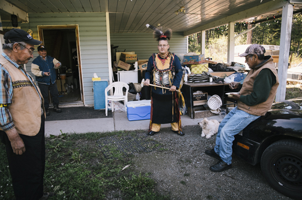 Ucwalmicw and N'quatqua with the native Demon Armon in indian N'quatqua traditional costume, Lake Andersen, British Columbia, Canada